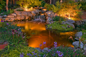 Garden lighting highlights flowers, water features and pathways.