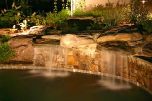 Columbus waterfalls are enhanced with outdoor lighting
